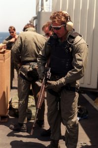 A member of Sea-Air-Land (SEAL) Team 8 checks his optical sight-equipped 7.62mm M-14 rifle aboard the fleet oiler USNS J0SHUA HUMPHREYS (T-AO-188).  SEAL Team 8 is providing boarding teams to assist the ships of the Maritime Interception Force in their enforcement of U.N. sanctions against Iraq during Operation Desert Storm.